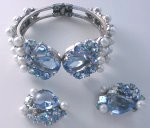 A great blue rhinestone and pearl bracelet and matching clip-earring set from Schiaparelli!