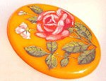 Here's a handsome bakelite brooch to pin upon your spring coat!