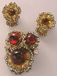 This brooch and earrings set is an incredible example of Miriam Haskell's hand-crafted jewelry!