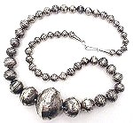 Hand crafted Navajo hollow silver beads in graduated sizes -- fabulous!