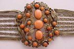 Gold over silver mesh and coral cabochons, wow!